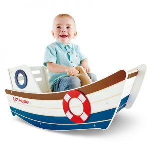 The Child's Wooden Rocking Boat - A wooden rocker in the shape of a tugboat that lets children set sail on high-seas adventures