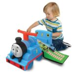 The Thomas The Tank Ride On - with a seat that unfolds to provide a racing track for included Thomas and Percy toy trains